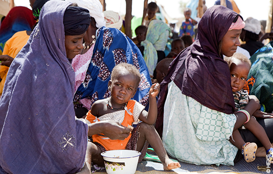 Women and children in Ethiopia receive food aid.
