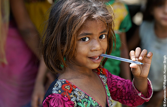 A schoolgirl in a slum in India.