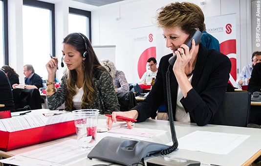 Simonetta Sommaruga receives donation pledges via telephone on a national fundraising day.